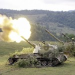 A Russian mobile artillery unit fires a 152mm shell towards a Georgian position outside the South-Ossetian settlement of Dzhava